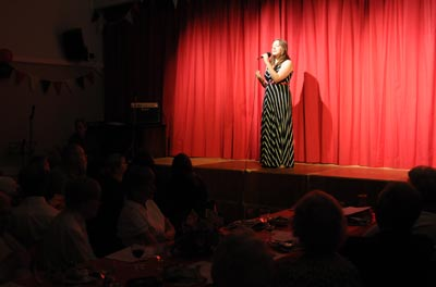 Singer on stage at North Curry Village Hall - photo